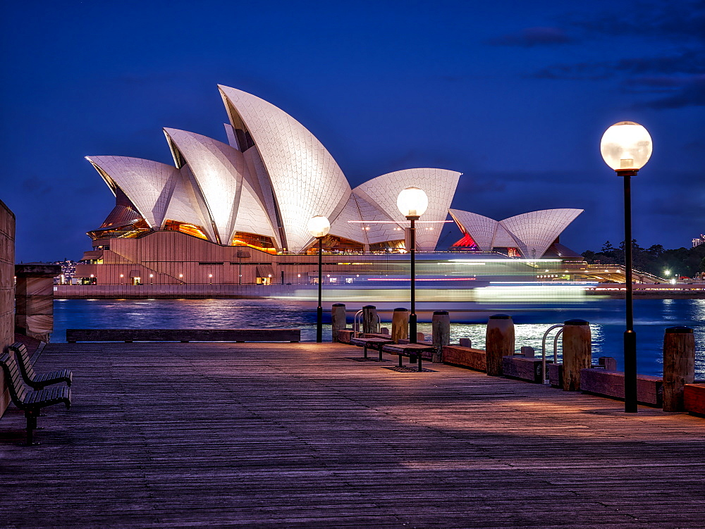 A boat passes by the Sydney Opera House, UNESCO World Heritage Site, during blue hour, Sydney, New South Wales, Australia, Pacific