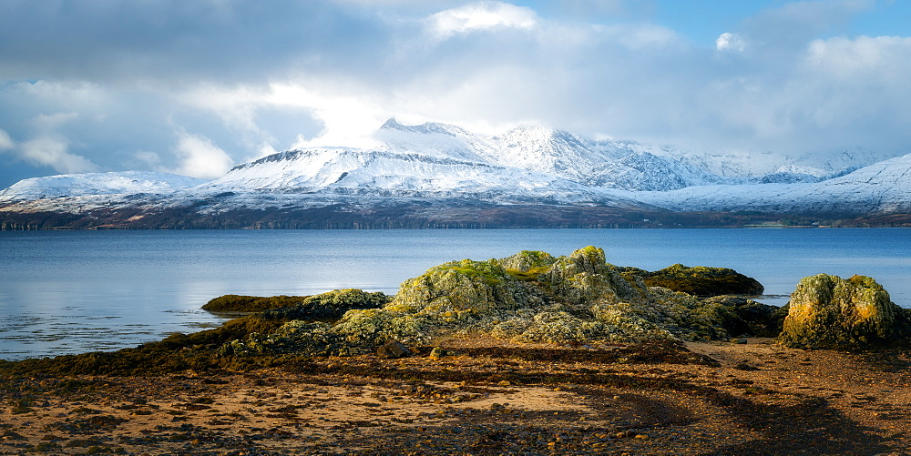Cuillin Mountain range in the snow from Ord Beach, Isle of Skye, Inner Hebrides, Scotland, United Kingdom, Europe
