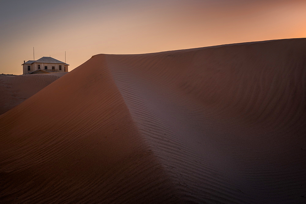 Old house amongst the sand dunes in the ghost town of Kolmanskop, Namibia, Africa - 1216-295