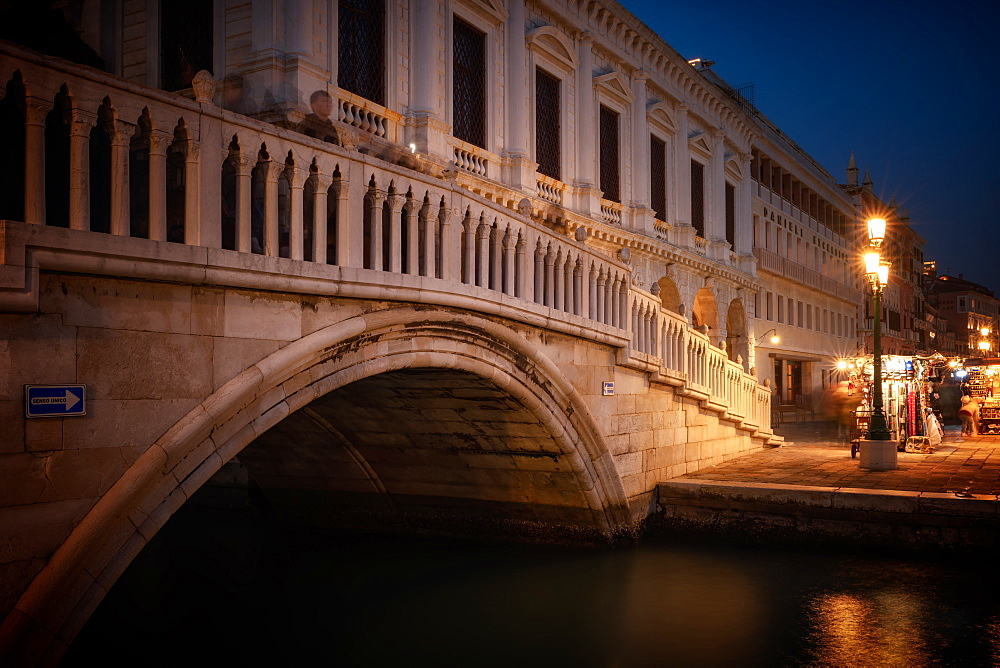 Ponte della Paglia bridge at night in Venice, Italy, Europe