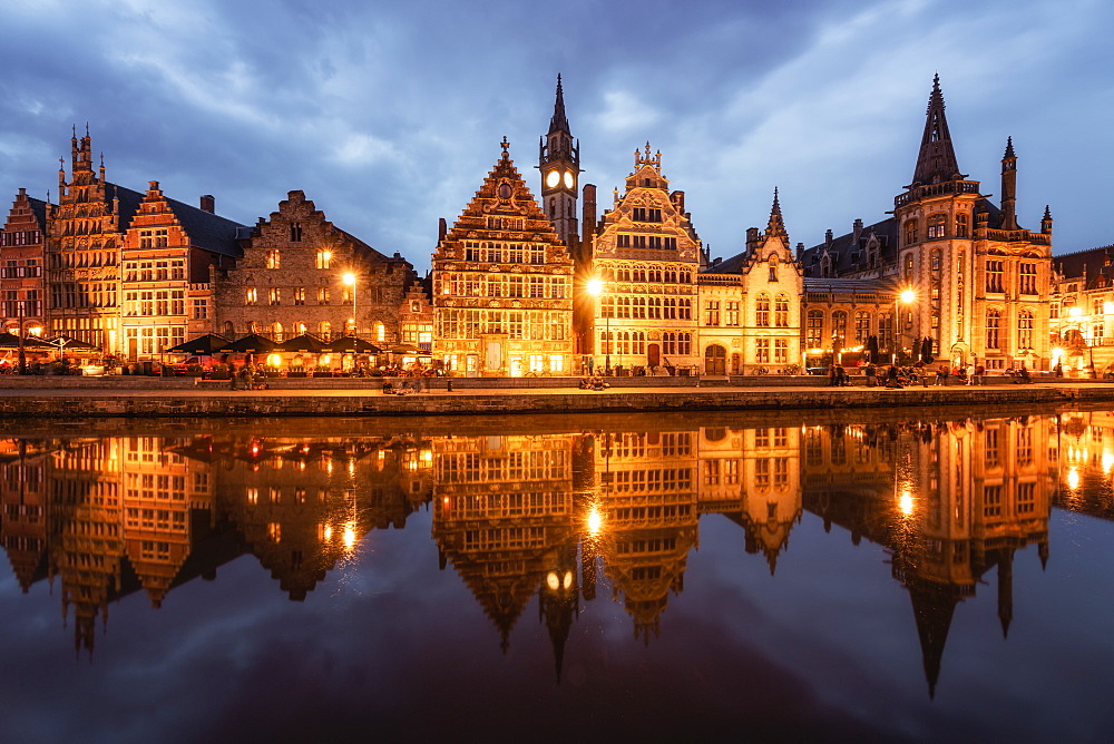 Graslei in the historic city of Ghent reflected in Leie river during blue hour, Ghent, East Flanders, Belgium, Europe