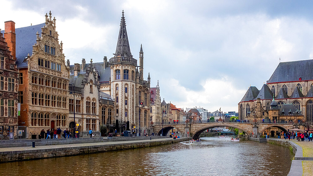 Graslei, Ghent, Belgium, Europe. Locals and visitors relax along the Leie canal, famous for its beautiful historic facades. - 1216-472