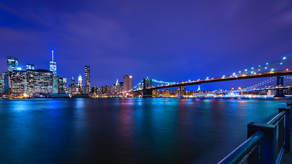Brooklyn Bridge and Manhattan skyline at dusk, New York City, New York, United States of America, North America