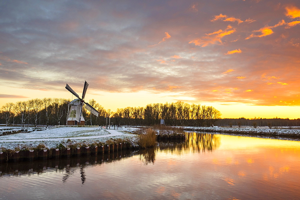 Witte Molen (White Mill) Dutch windmill in winter at sunset, Harn, Groningen, North Holland, Netherlands, Europe