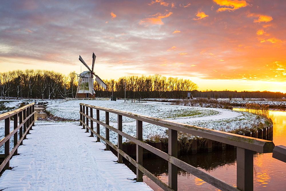 Witte Molen (White Mill) Dutch windmill in winter at sunset, Harn, Groningen, North Holland, Netherlands, Europe