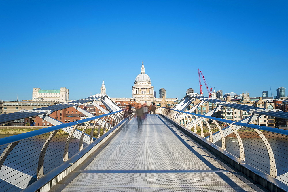 United Kingdom, England, London. Millennium Bridge (London Millennium Footbridge) over River Thames, St Paul's Cathedral in back