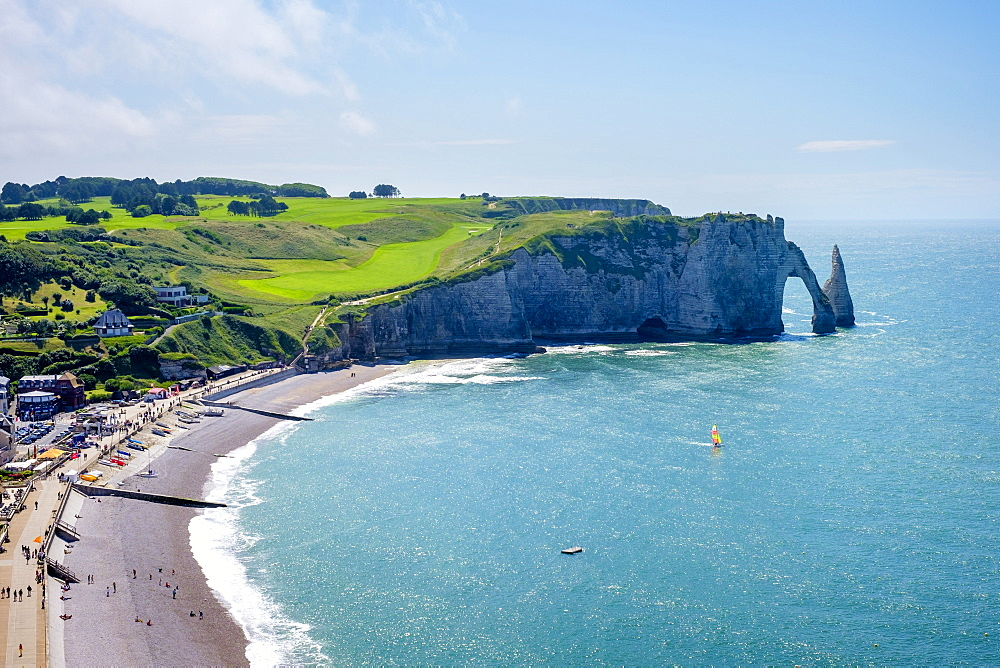 France, Normandy, Seine-Maritime department, Etretat. White chalk cliffs and Aiguille d'Etretat, natural stone arch on the coast