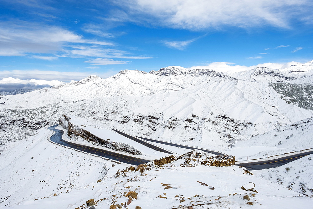 Winding road through Tizi N'Tichka pass in the Atlas Mountains during winter snow, Marrakech-Safi, Al Haouz Province, Morocco, North Africa, Africa