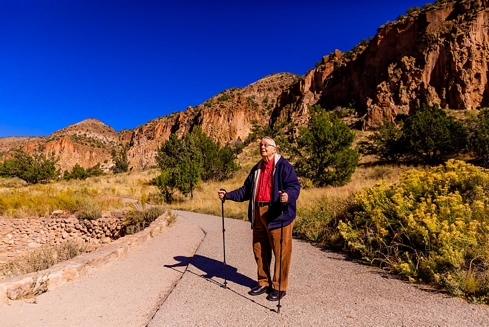 Old man walking through the Pueblo Indian Ruins in Bandelier National Monument, New Mexico, United States of America, North America - 1218-1103