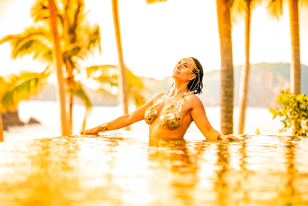 Ondalinda festival, Gold infinity pool photo shoot, El Careyes, Mexico, North America
