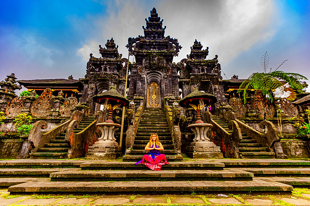 Woman at the Besakih Temple, the most important, largest, and holiest temple of Hindu religion in Bali.
