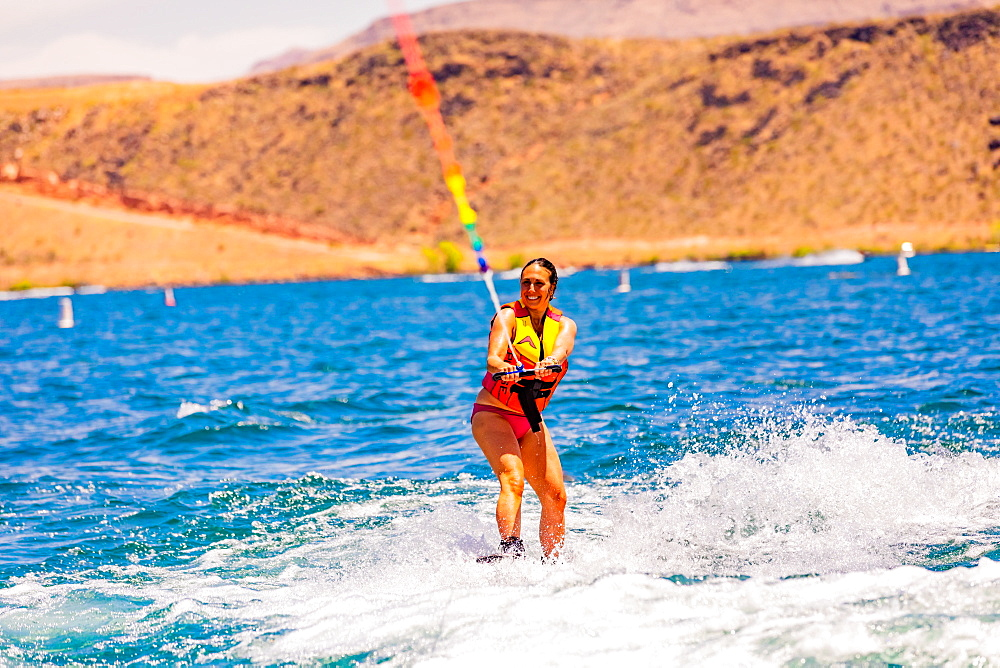 Woman wake boarding at the Sand Hollow Reservoir, Utah, United States of America, North America - 1218-1307