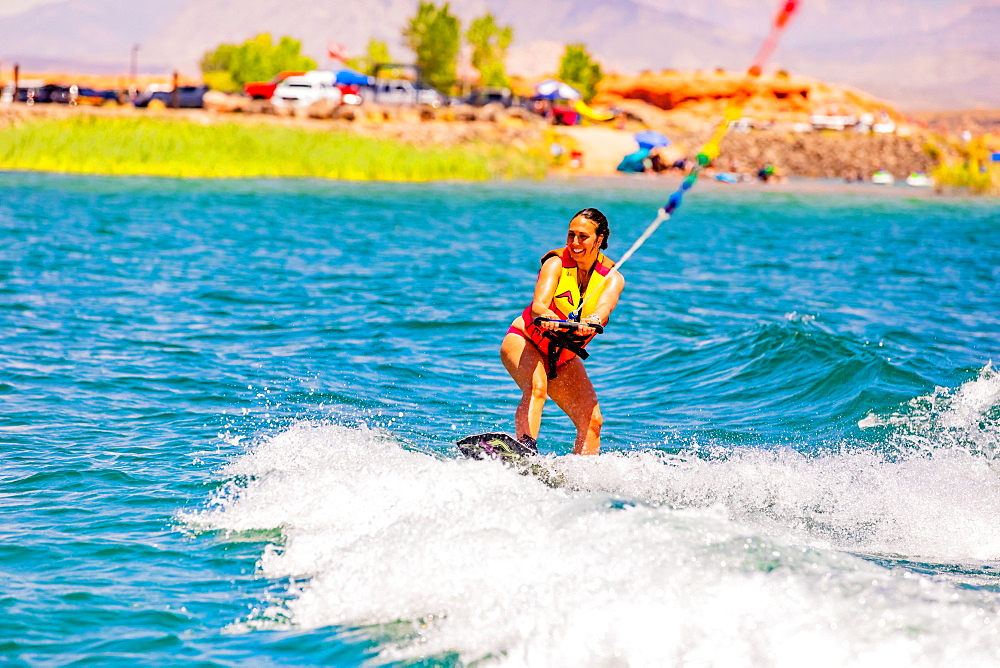 Woman wake boarding at the Sand Hollow Reservoir, Utah, United States of America, North America