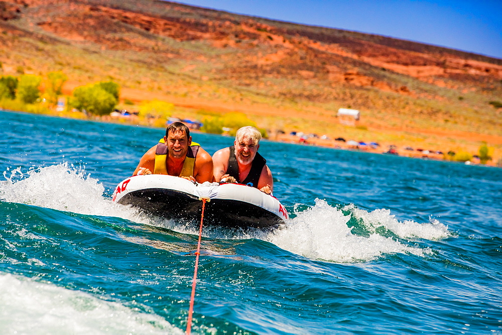 Two friends tubing in Utah. - 1218-1315