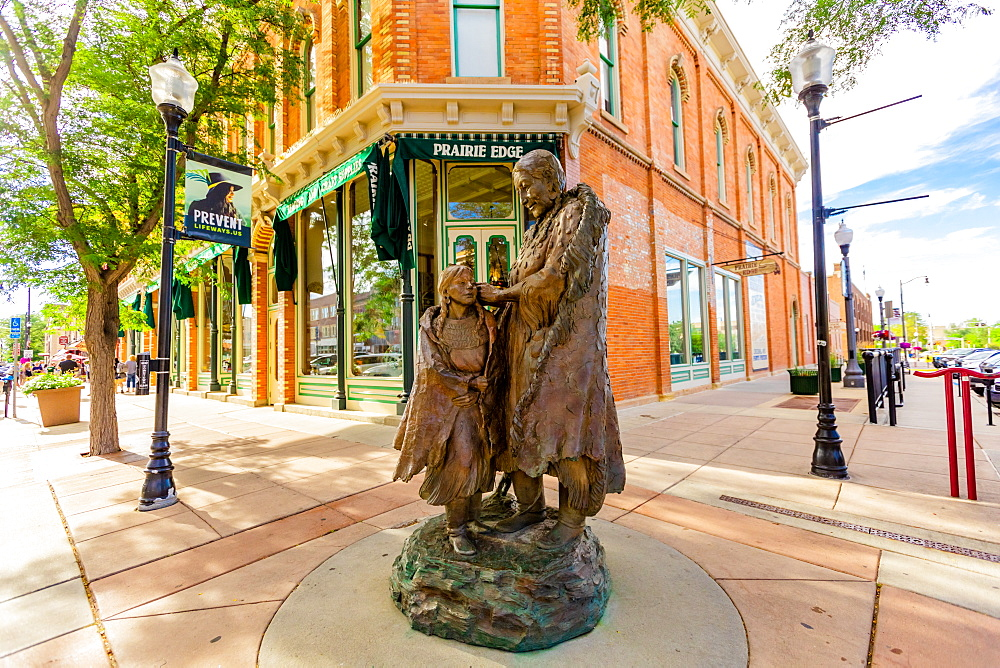 A statue of a Sioux Native American woman and her daughter in downtown Rapid City. - 1218-1344