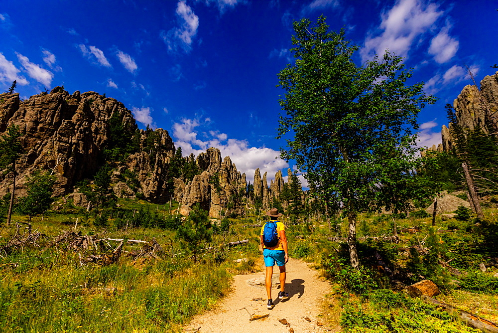 Man hiking the trails and enjoying the sights in the Black hills of Keystone. - 1218-1348