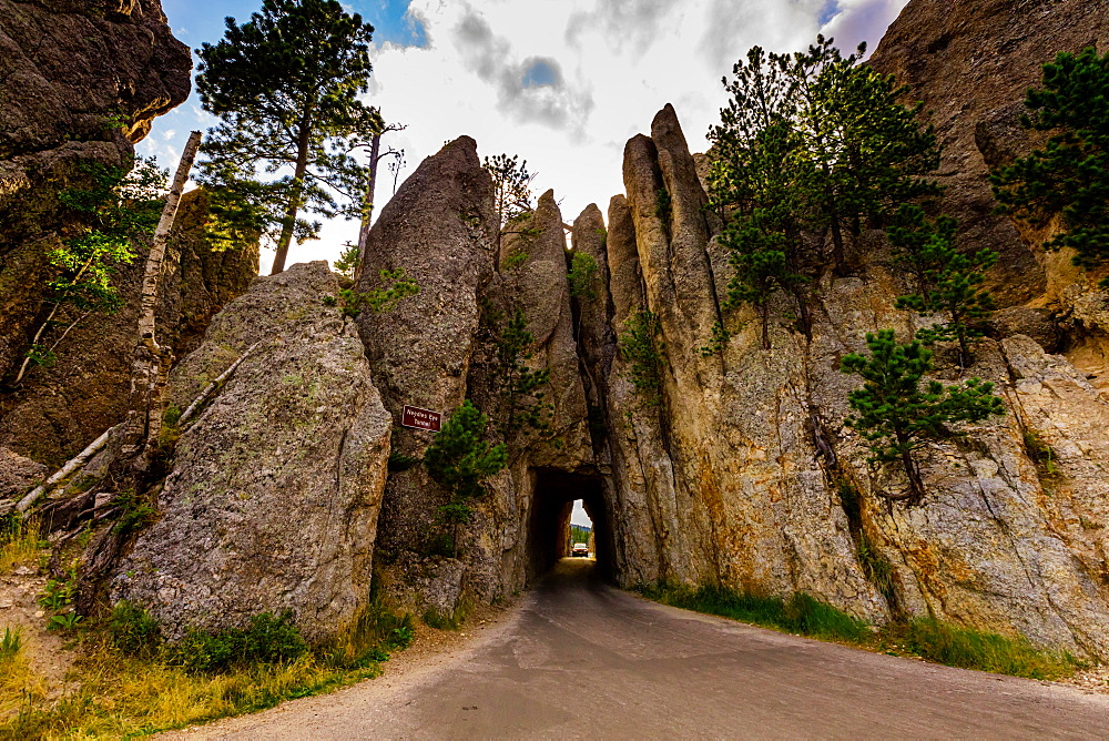 Tiny road passing under a small mountain in the Black Hills of Keystone.