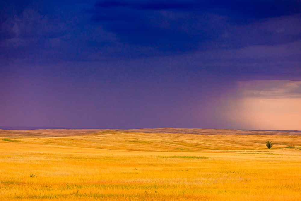 Rolling plains against a dark stormy sky in the Badlands. - 1218-1353