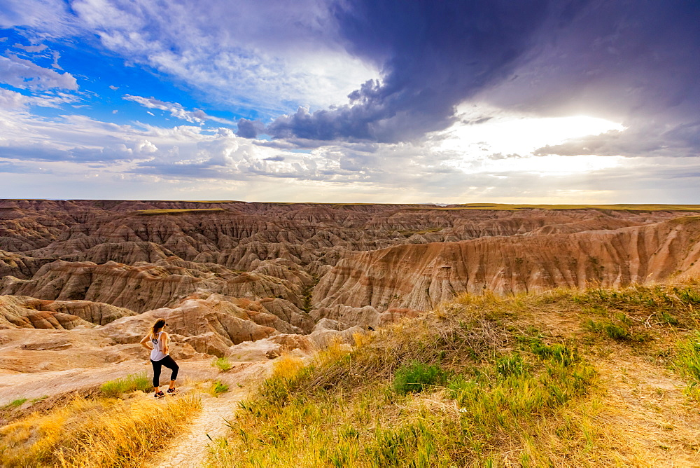 Woman hiking her way through the scenic Badlands.