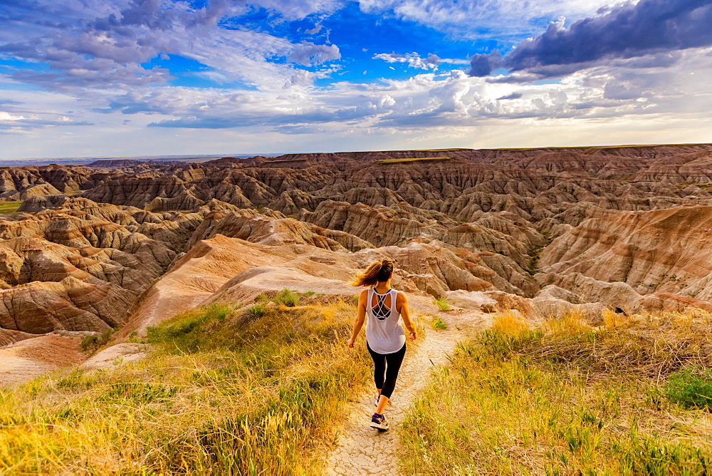 Woman hiking her way through the scenic Badlands. - 1218-1361