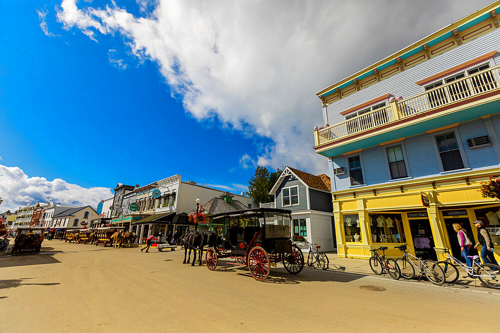 Horse and carriage filled streets lined with beautiful colorful buildings, Mackinac Island, Michigan, United States of America, North America - 1218-1391