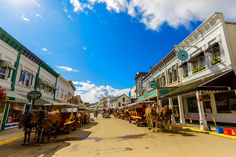 Horse and carriage filled streets lined with beautiful colorful buildings, Mackinac Island, Michigan, United States of America, North America - 1218-1392