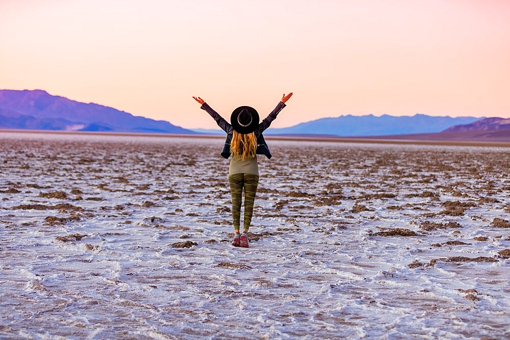 Model posing for the camera at sunset over the salt flats of the Mesquite Dunes, California, United States of America, North America - 1218-1412
