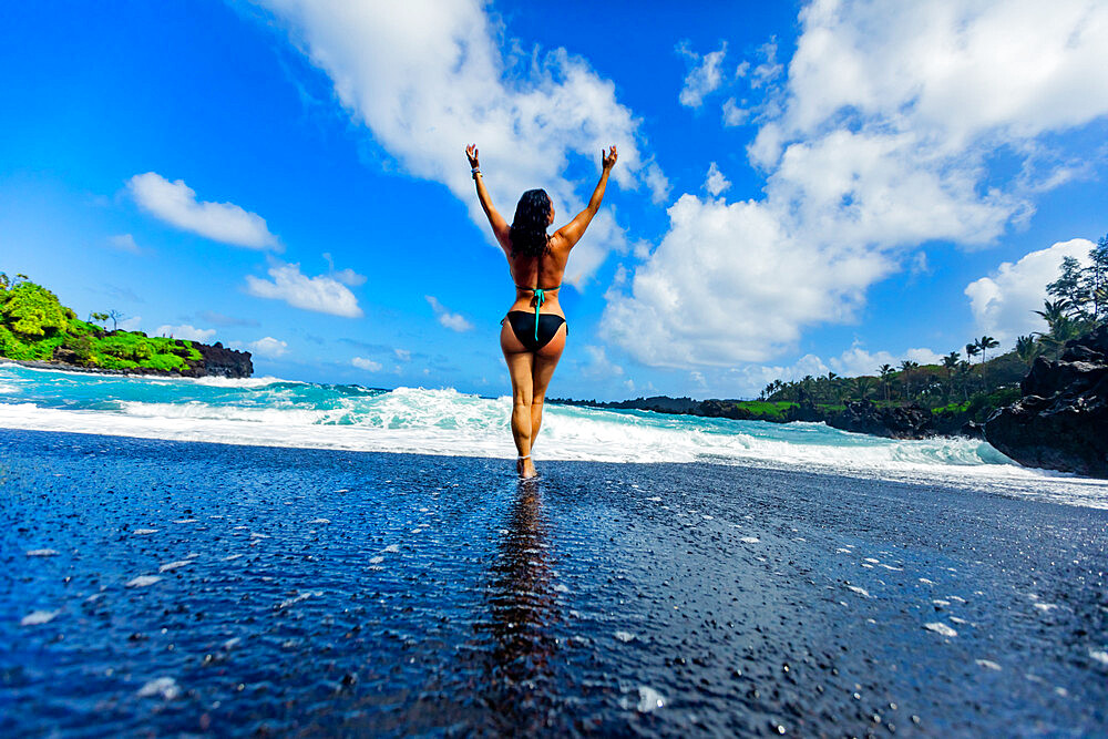 Woman enjoying the sun on one of Maui's black sand beaches, Hawaii, United States of America, North America - 1218-1417