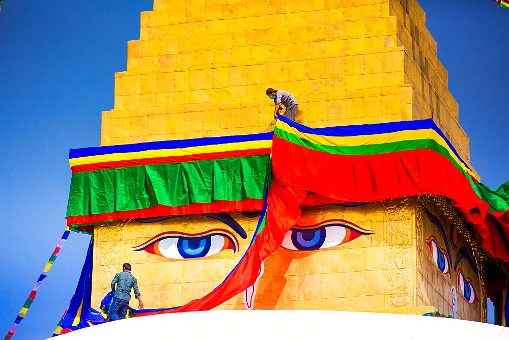 Buddhist Monks decorating the temple at Bouddha (Boudhanath), UNESCO World Heritage Site, Kathmandu, Nepal, Asia