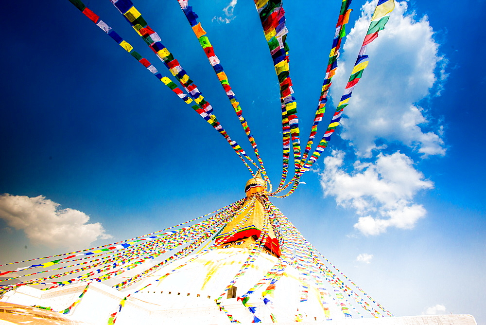 Prayer flags and Buddhist stupa at Bouddha (Boudhanath), UNESCO World Heritage Site, Kathmandu, Nepal, Asia