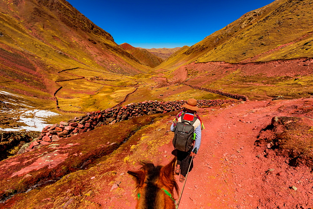 Hiking across the Rainbow Mountain chain in the Andes, Peru, South America