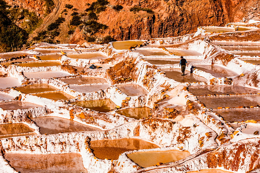 Salt terraces in the Sacred Valley where people are still mining and sifting the terraced pools as the Incas did 1000 years ago, Peru, South America