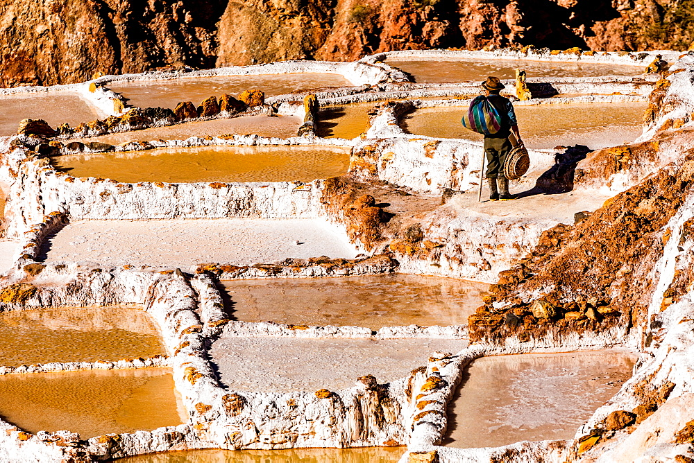 Salt terraces in the Sacred Valley where people are still mining and sifting the terraced pools as the Incas did 1000 years ago, Peru, South America - 1218-736