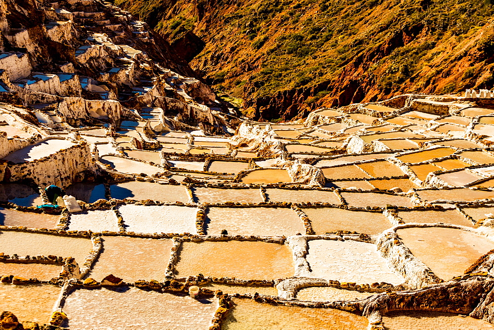 Salt terraces in the Sacred Valley where people are still mining and sifting the terraced pools as the Incas did 1000 years ago, Peru, South America - 1218-737