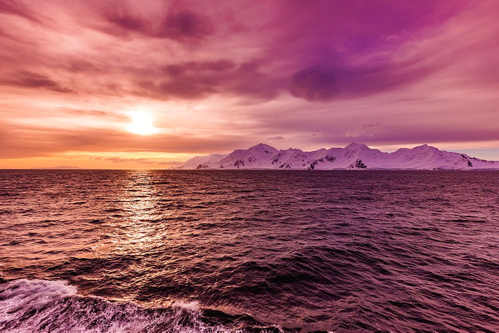 Sunset and a scenic view of the glacial ice and floating icebergs in Antarctica. - 1218-787