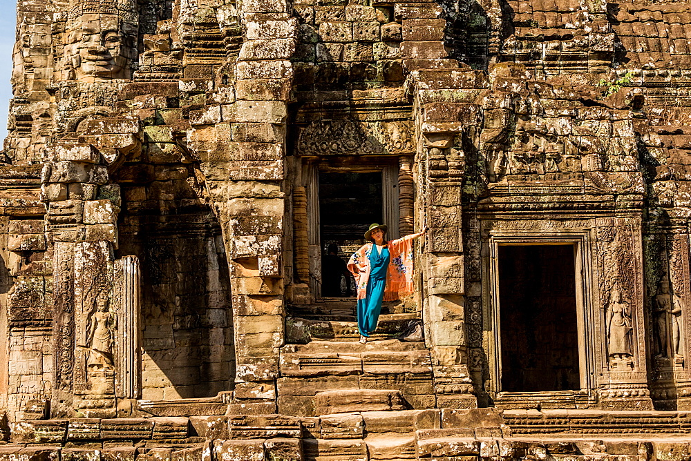 American woman tourist at Angkor Wat temples at Siem Reap in Cambodia.