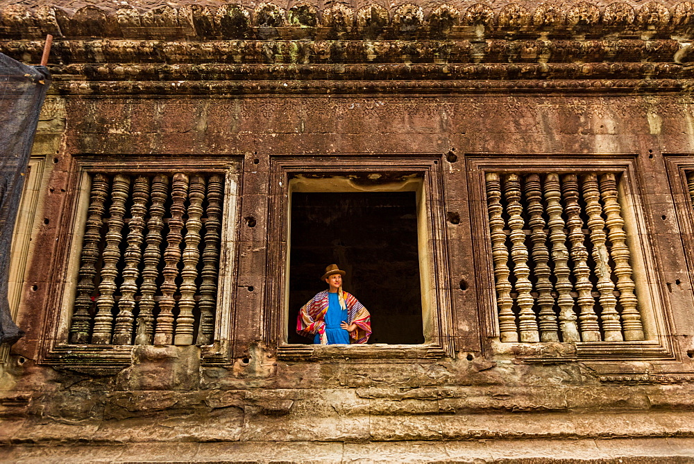 Woman tourist at Angkor Wat, Siem Reap in Cambodia.