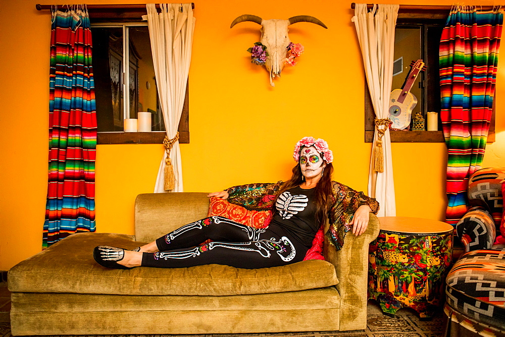 Woman in Dia de los Muertos makeup and costume, Day of the Dead celebration in the desert, California, United States of America, North America