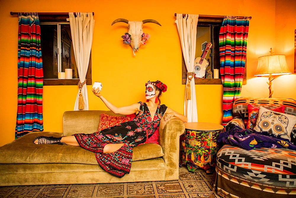 Day of the Dead celebration in the desert. Dia de los muertos makeup and costume.