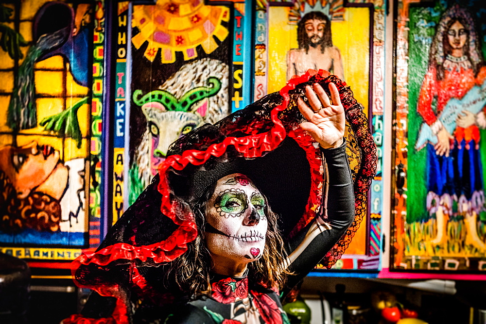 Day of the Dead celebration in the desert. Woman in dia de los muertos makeup and costume.