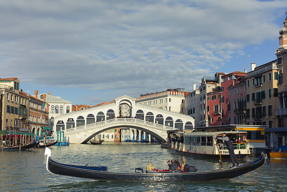 A gondola crossing the Grand Canal with a vaporetto and the Rialto Bridge beyond, Venice, UNESCO World Heritage Site, Veneto, Italy, Europe - 1219-276