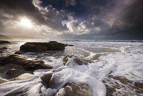 Surf foam at Gwenver Beach, South West Cornwall, England, United Kingdom, Europe