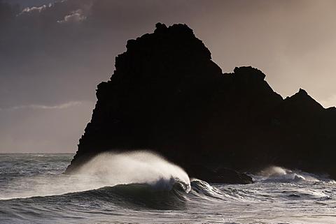 Stormy winter sunshine and powerful Atlantic surf at Kynance Cove on the Lizard Peninsula, Cornwall, England, United Kingdom, Europe