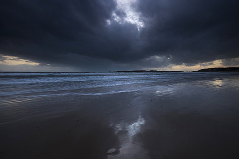 Surf at low tide under a storm over Llanddwyn Beach, West Anglesey, Wales, United Kingdom, Europe