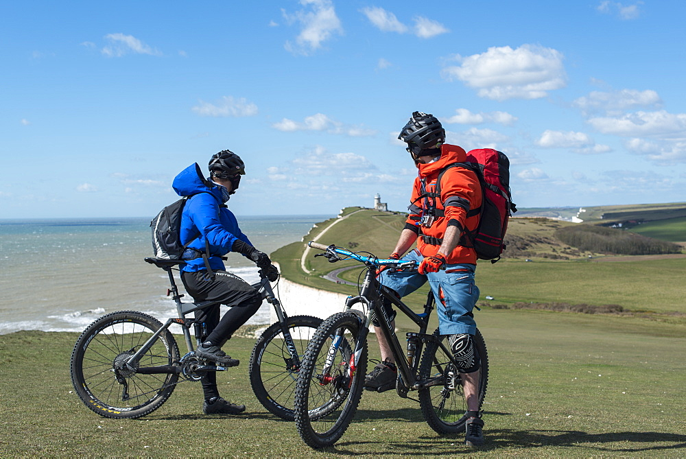 Mountain biking along the chalk cliffs coastal path on the South Downs way near Beachy Head in England
