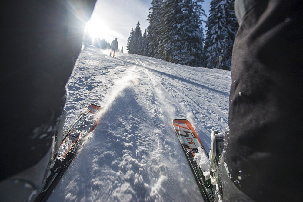 Point of view shot through the legs, of the slopes skiing near Garmisch, Bavaria, Germany, Europe