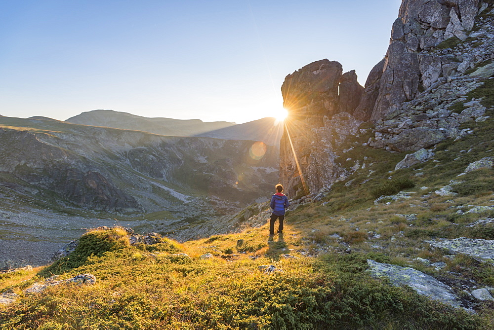 The last rays of sun disappear behind a rock face after a day of trekking in the Rila Mountains, Bulgaria, Europe - 1225-1192