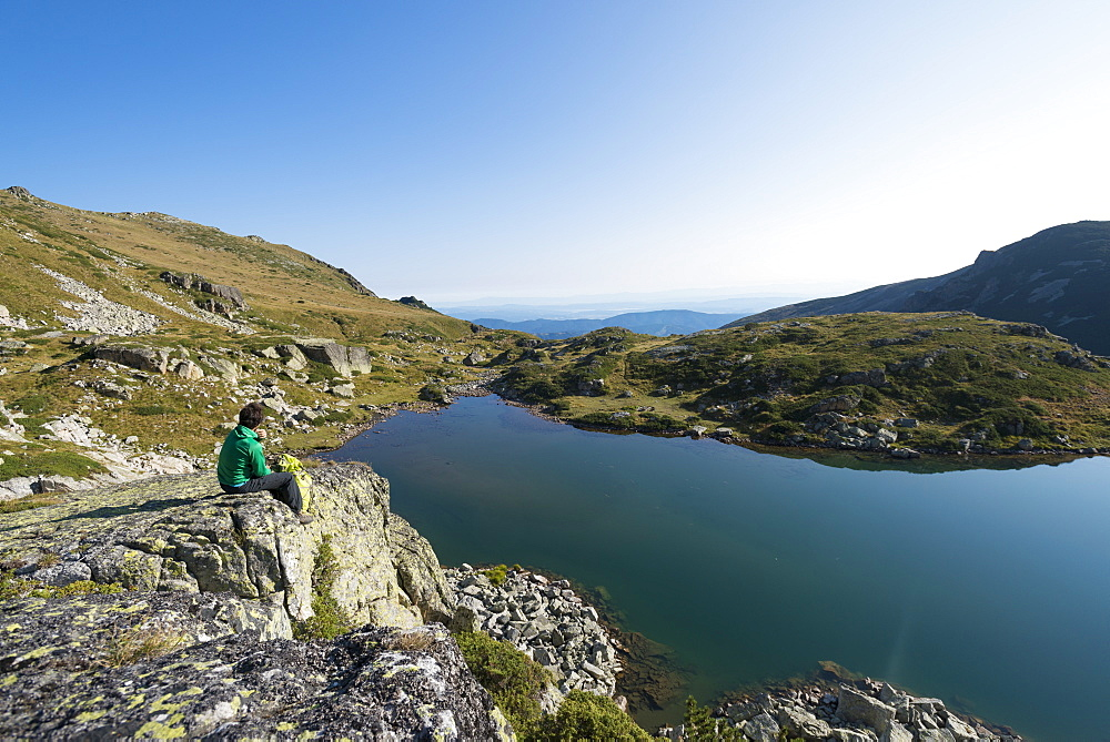 Hiking next to one of the Maliovitsa lakes in the Rila mountains in Bulgaria