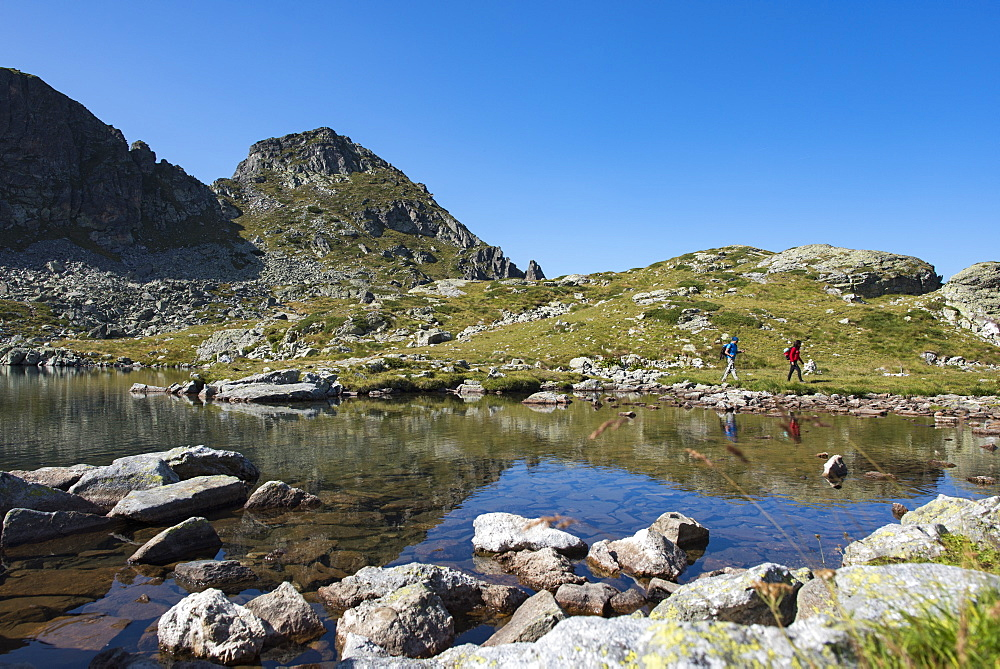 Hiking next to the clear water of Elenino Lake near Maliovitsa in the Rila mountains in Bulgaria