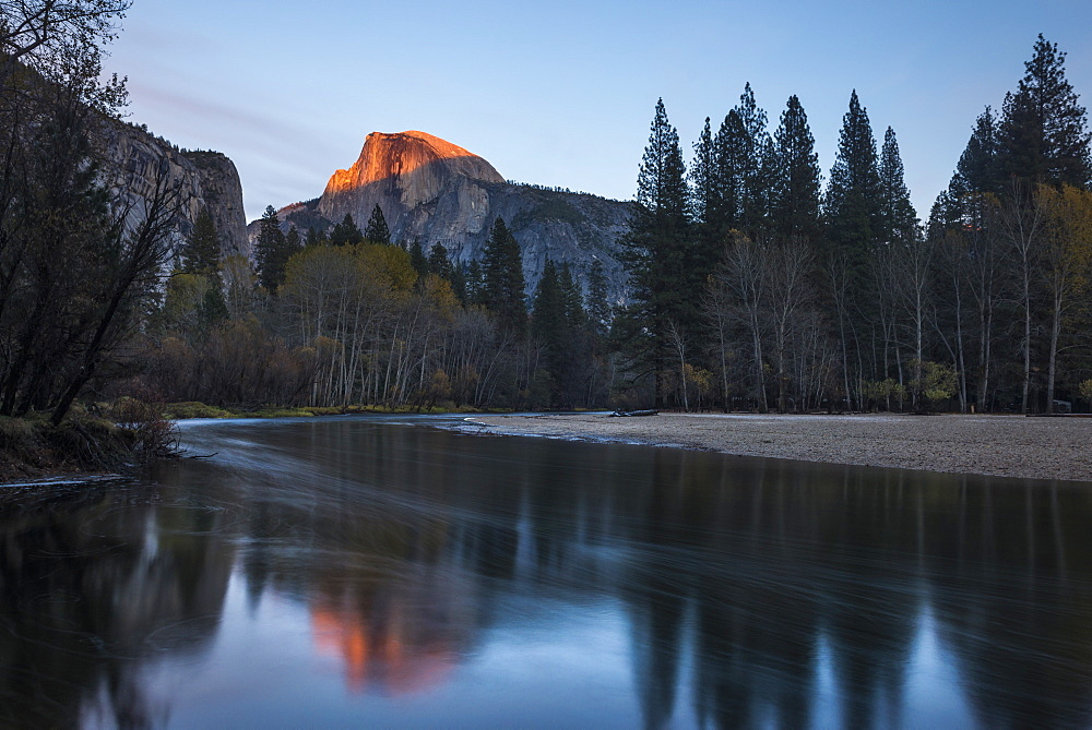Half Dome mountain catches the last glow of sunset reflected in the Merced river in Yosemite National Park, UNESCO World Heritage Site, California, United States of America, North America